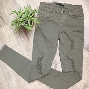 Olive green distressed skinny jeans